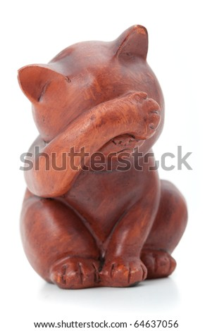 I see nothing concept. Wooden statuette of cat over white background. - stock photo