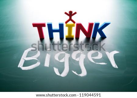 I think bigger concept, words on blackboard - stock photo