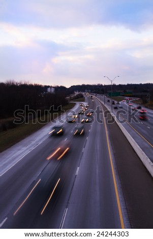 I-75 traffic into Knoxville at dusk. - stock photo