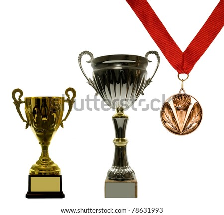 I won them all!- 2 cups and one medal on a white background - stock photo