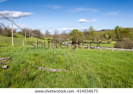 Iberian gauge railway track in the mining area of the Fenar Valley, La Robla Municipality, in Leon Province, Spain. - stock photo
