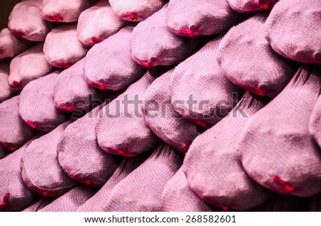 Iberian serrano hams hanging in the store. Serrano ham is the typical spanish ham - stock photo