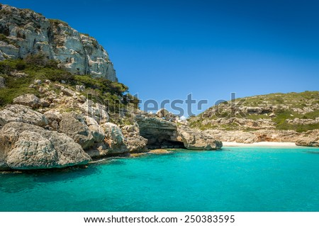 Ibiza bay Cala Marmolis with famous wild sand beach and turquoise water. Baleares, Spain - stock photo