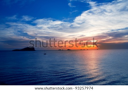 Ibiza cala Conta Conmte sunset with bledas and esparto islands - stock photo
