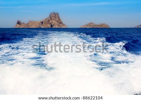 Ibiza Es Vedra from boat prop wash wake in Balearic Mediterranean sea - stock photo