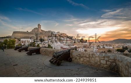 Ibiza fortress and cannon square at sunset. Eivissa island, Spain - stock photo