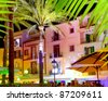 Ibiza island nightlife in Eivissa town white houses and palm trees - stock photo