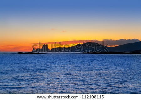 Ibiza island sunset with Es Vedra in background at Balearic islands - stock photo