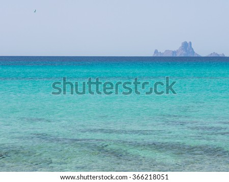 Ibiza islands of Es Vedra i Es Vedranell seen from Formentera beach of Ses Illetes