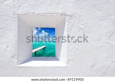 Ibiza mediterranean white wall window with Formentera beach view [photo-illustration] - stock photo