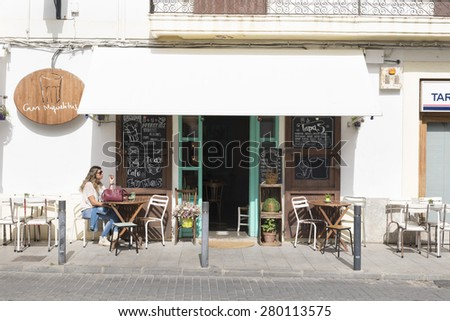 IBIZA, SPAIN - MAY 13, 2015: Ibiza Old Town. A picturesque street of the old town of Ibiza, with its whitewashed houses and bars, restaurants and shops