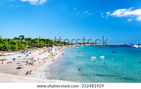 Ibiza, Spain- September 21, 2013: People swimming and sunbathing on the picturesque Las Salinas beach. Ibiza, Balearic islands. Spain - stock photo