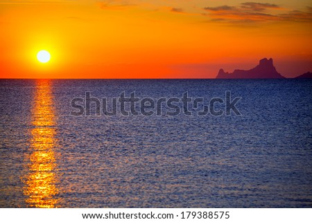 Ibiza sunset Es Vedra view from Formentera la Savina red orange sky - stock photo