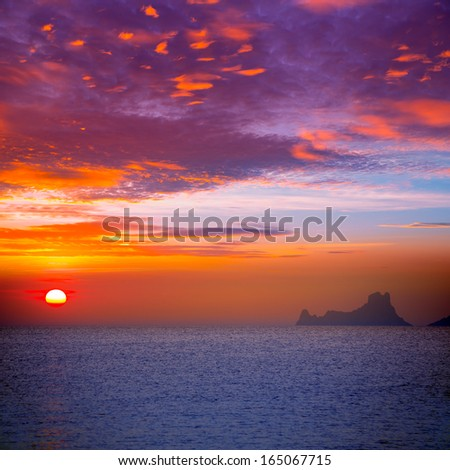Ibiza sunset view from formentera Island in Balearic Islands - stock photo