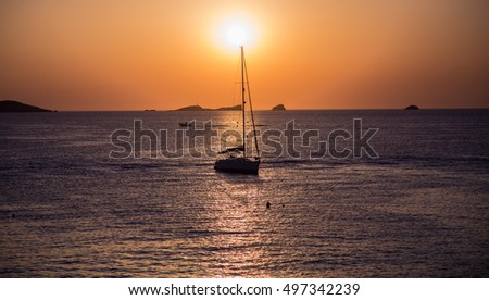 Ibiza sunset with boat on the sea