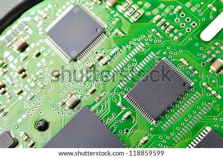 ic on Green circuit board - stock photo