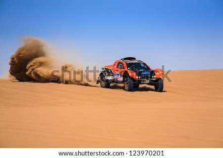 ICA, PERU - JAN. 05:  Guillaume Gomez (FRA) Drive his car during his participation on Rally Dakar 2013, JAN 05, 2013 in Ica, Peru. - stock photo
