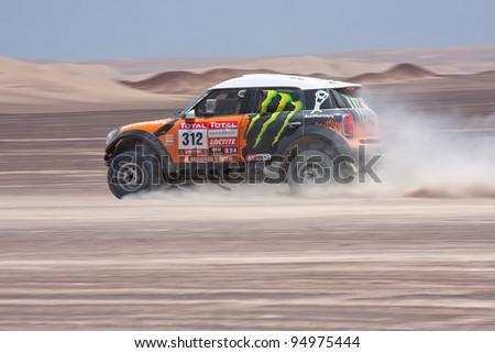 ICA, PERU - JAN. 14: Leonid Novitskiy (RUS) Drive his car during his participation on Rally Dakar 2012 Argentina Chile Peru, Jan. 14, 2012 in Ica, Peru. - stock photo
