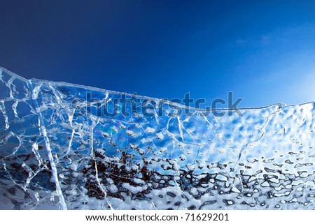 Ice against the blue sky.  A structure of the frozen water.Blue ice abstract natural background - stock photo