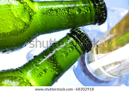 Ice and beer - stock photo