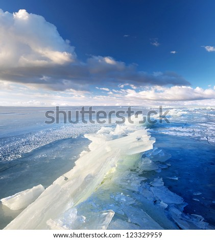 Ice and dark sky with clouds. - stock photo