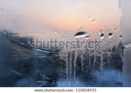 Ice and water drop on a winter glass - stock photo