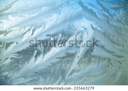 Ice at a window in clear frosty day in the cold winter - stock photo