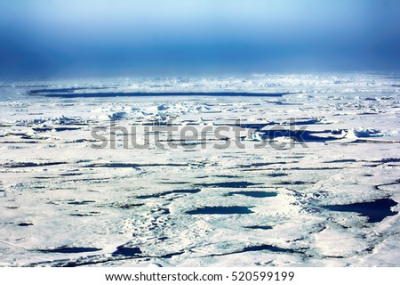 ice at North pole and near (85-90 degrees) in 2016. Arctic Effect. Light strip at top is so - called ice sky (iceblink), dark on horizon water sky (there is opening). So saw conquerors of North pole
