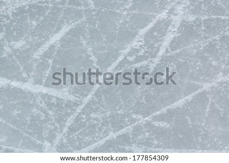 ice background with marks from skating and hockey - stock photo