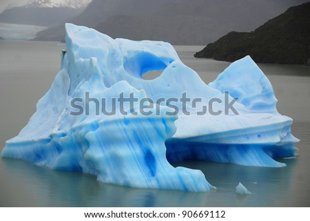 Ice berg, Torres del Paine, Chili is probably the world's most spectacular national park. An unrivalled landscape of mad jagged peaks, impossibly blue lakes, deserted pampas and iceberg-loaded rivers. - stock photo