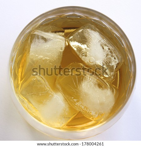 Ice Blocks in a Glass of Whiskey - stock photo