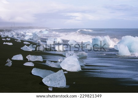 Ice blocks on a black sand beach near Jokulsarlon lagoon, Iceland