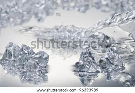 Ice blocks over wet surface - stock photo