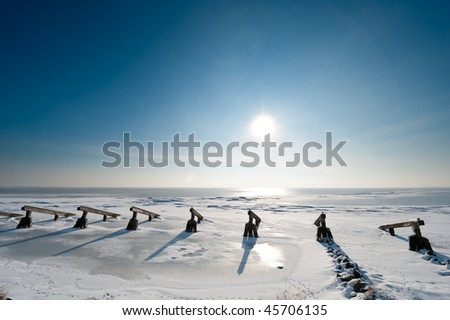 Ice breakers in winter (Marken small village near Amsterdam) - stock photo