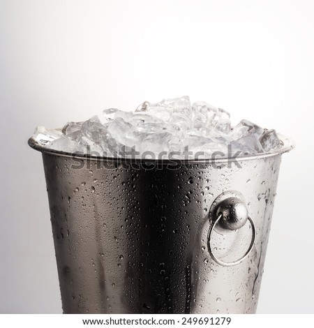 Ice bucket filled with ice cubes - stock photo