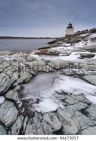 Ice builds on the rocks at Castle Hill Lighthouse in Newport,RI.