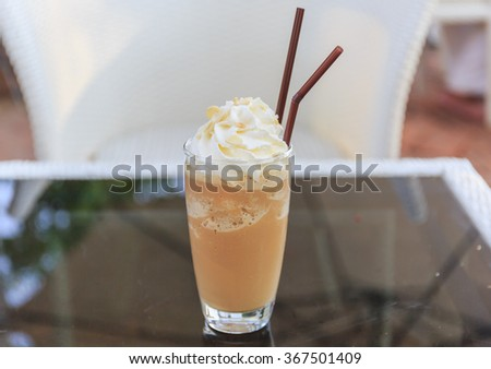 Ice cappuccino and cream - stock photo