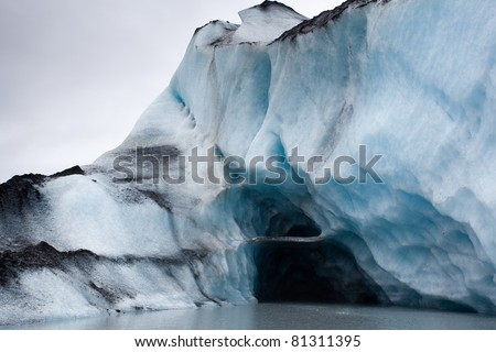 Ice cave inside glacier iceberg in Alaska - stock photo