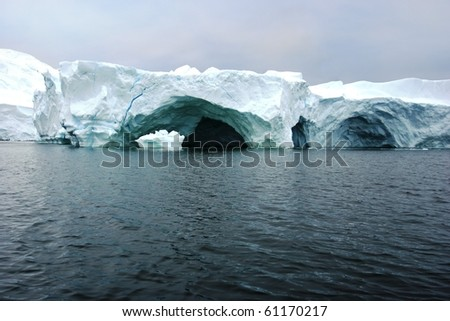 ice caves in the antarctic - stock photo