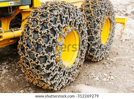 ice chains on tires. Industrial security for cold weather tool - stock photo