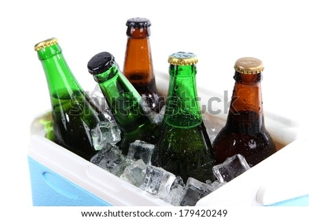 Ice chest full of drinks in bottles, isolated on white - stock photo