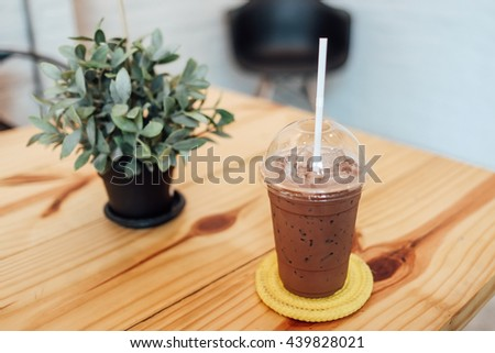 ice chocolate  a wooden table. - stock photo