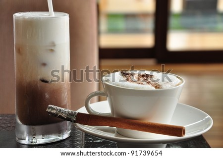Ice chocolate and hot cappuccino - stock photo