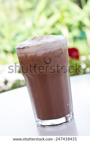 Ice chocolate drink in decorated tall glass - stock photo