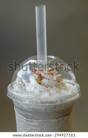 Ice chocolate frappe and whipped cream in the takeaway plastic cup