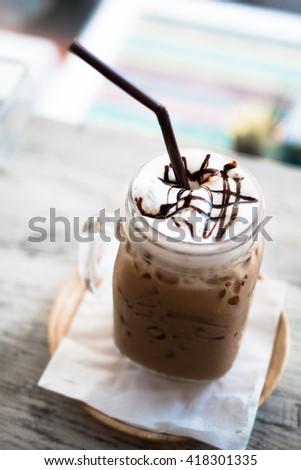ice chocolate on wooden table - stock photo