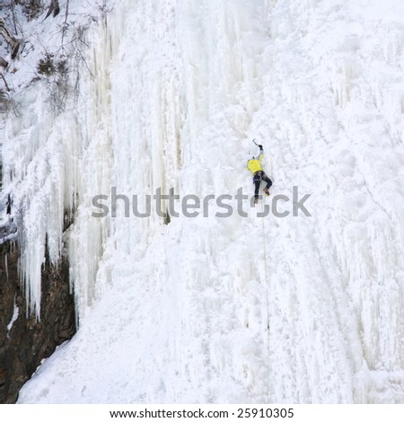 ice climbing at the by the waterfall Montmorency near Quebec City, Canada - stock photo