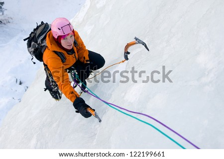 Ice climbing woman - stock photo