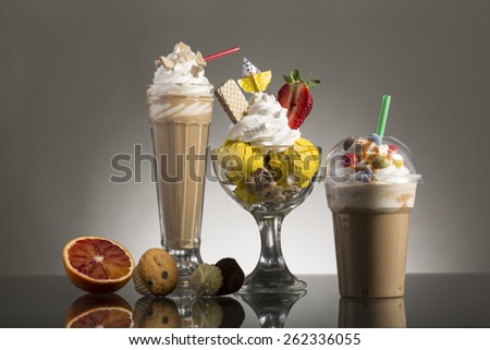 ice coffee and ice coffee take-away, and Neapolitan cup with vanilla ice with whipping cream decorated for menu card - stock photo
