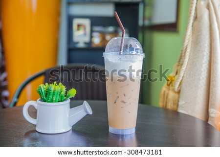 Ice coffee on the table. - stock photo